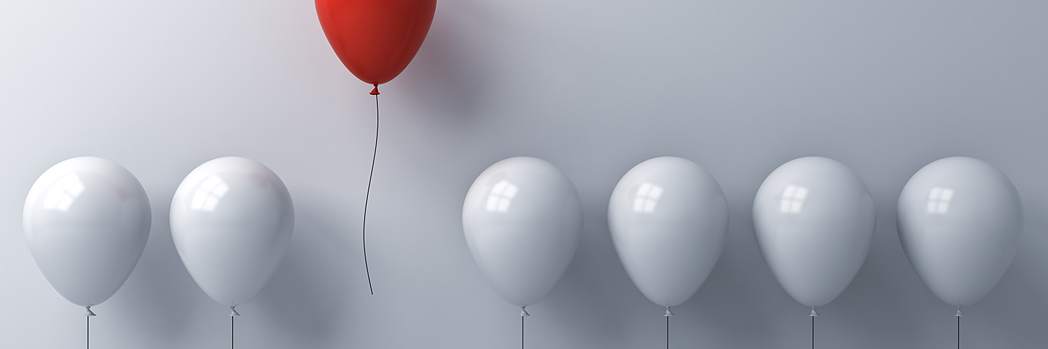 White balloons and one red balloon