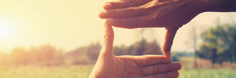 Hands framing sunset