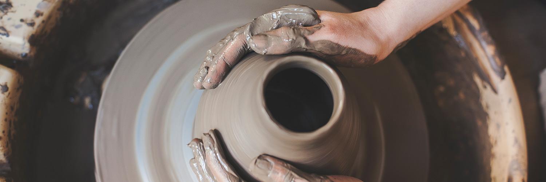 Hands forming a pot